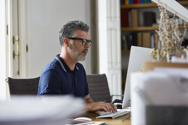 Businessman using computer in office