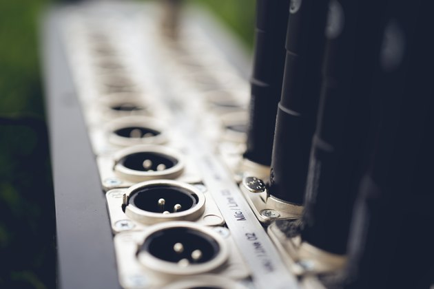 Series of connection xlr connector. Rear of sound control panel. Close up.