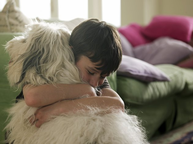 Boy hugging his dog