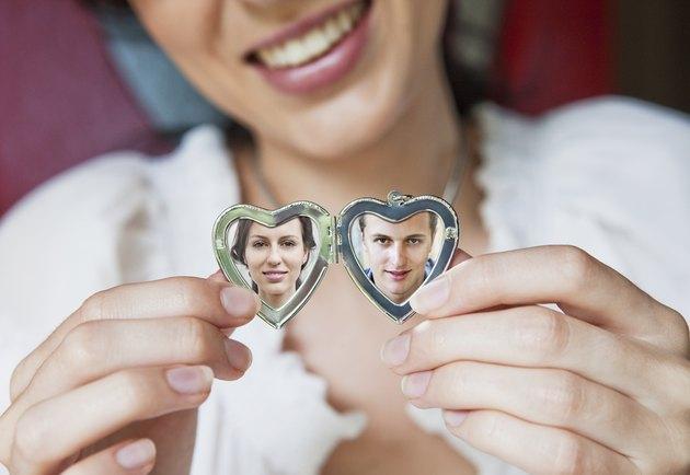 woman showing her boyfriend in locket