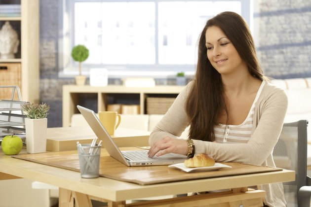 Young woman with laptop in the morning