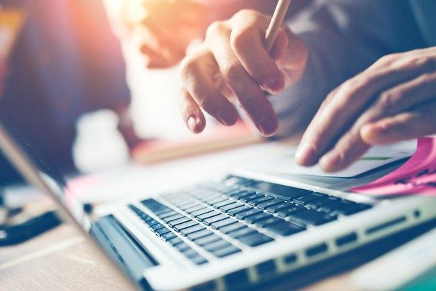 Typing on laptop close-up