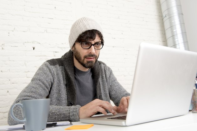 corporate portrait  young hispanic hipster businessman working at office