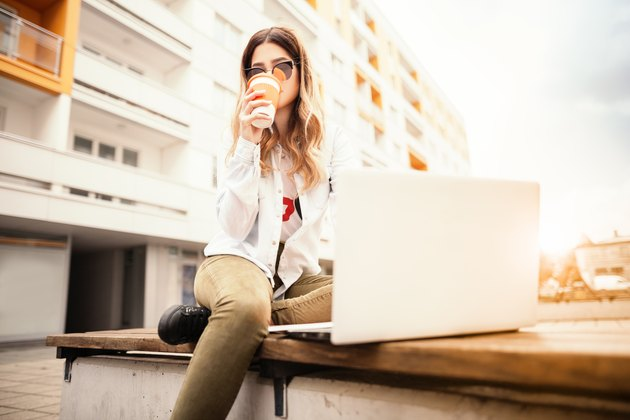 Young woman with a book and coffee.