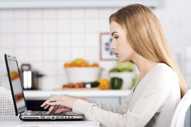 Beautiful caucasian woman working on laptop.