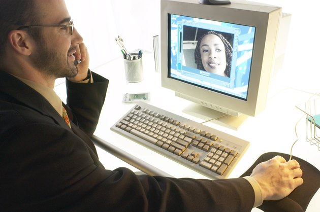 Businessman watching video conference