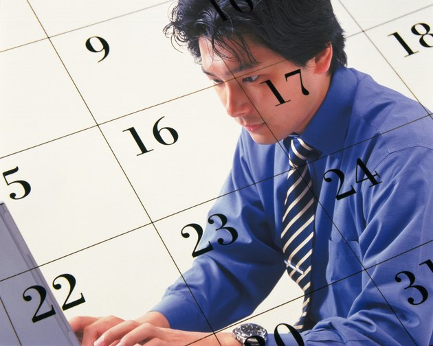 Businessman using laptop and image of calendar, CG, composition, side view