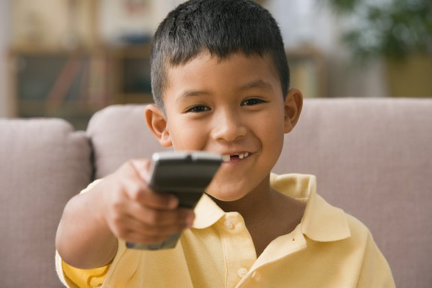 Young boy using a remote control