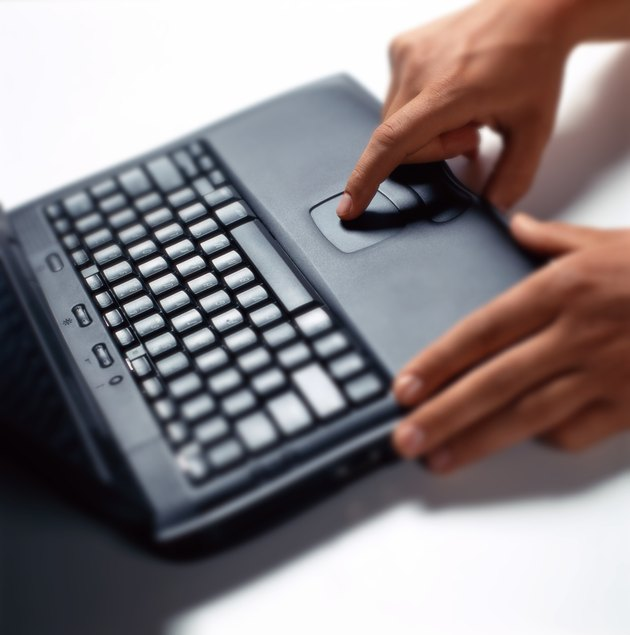 person using the touch pad on a laptop