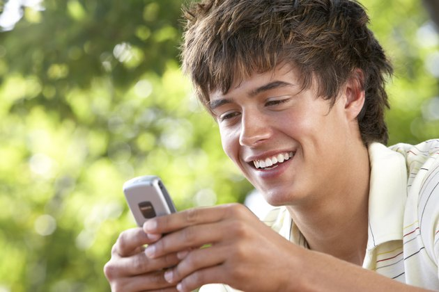 Teenage boy with cellular phone