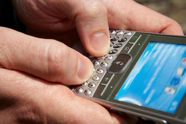 Close-up of person texting on smartphone