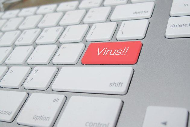 computer keyboard with word Virus