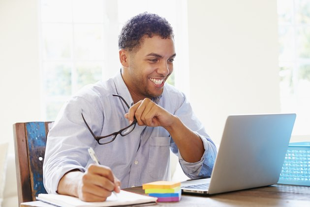 Businessman Working In Office At Home