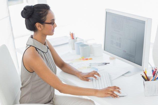 Designer working at her desk using computer