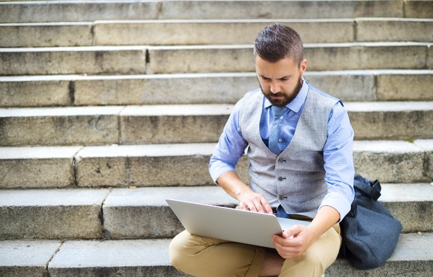 Hipster businessman with laptop