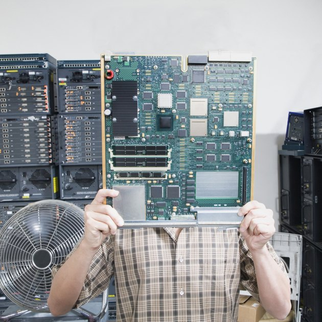 Man hiding behind circuit board