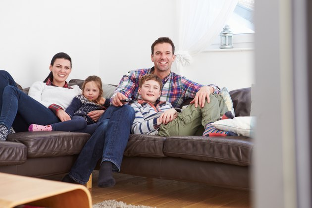 Family Relaxing Indoors Watching Television Together