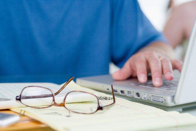 Man with laptop computer and eyeglasses