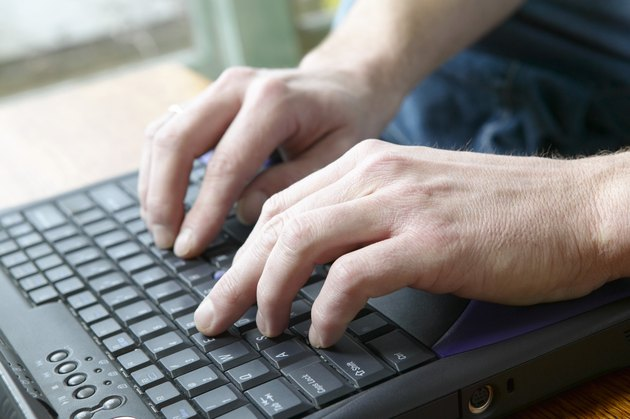 Man typing on keyboard