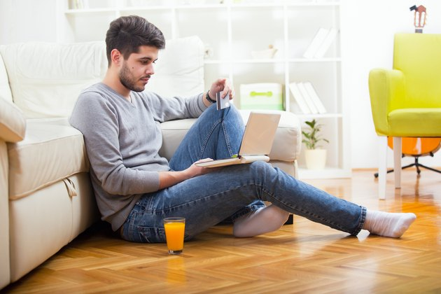 Casual  paying online with credit card at home