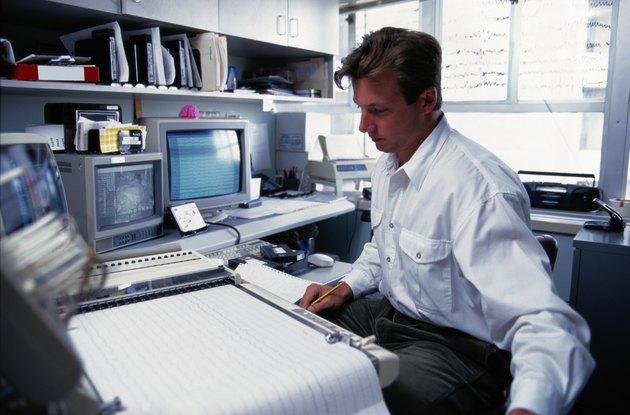 Man Looking at Printout