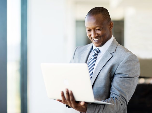 african business man using laptop