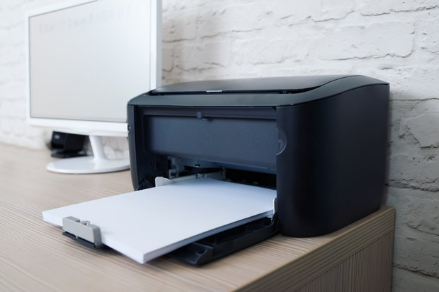 printer with paper on workplace