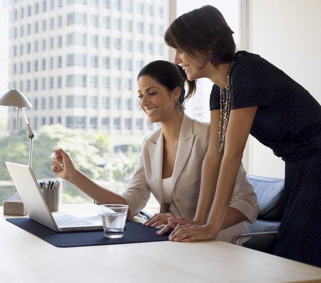 Businesswomen working on laptop computer