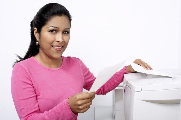 Woman next to a printer