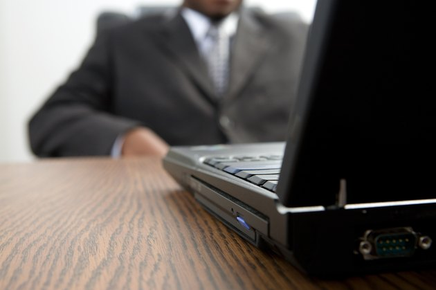 Laptop computer and man in office