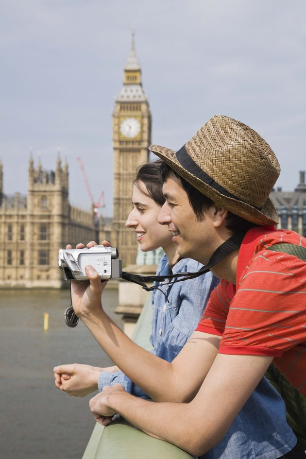 Couple with video camera, London, England