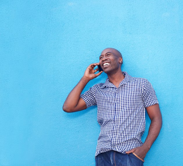Modern african man talking on cell phone