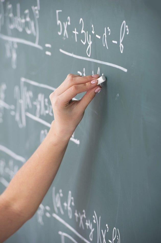 At the blackboard.
