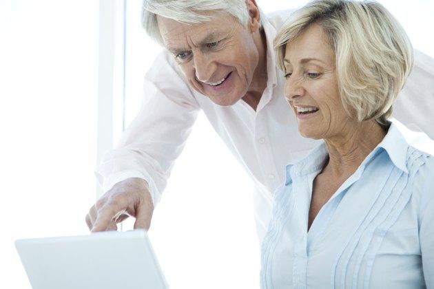 Happy Senior Couple communicating online.