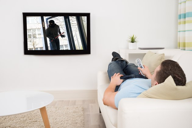 Man Watching Movie On Television In Living Room