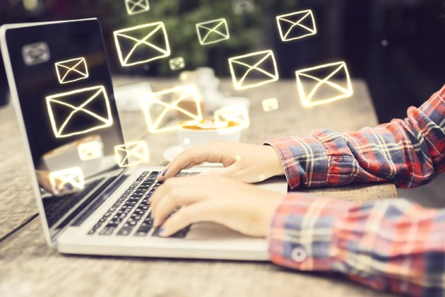 Email concept with laptop ang girl hands