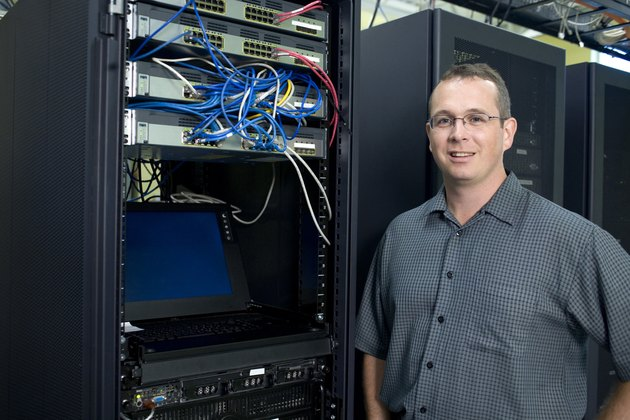 Portrait of a technician standing in a server room