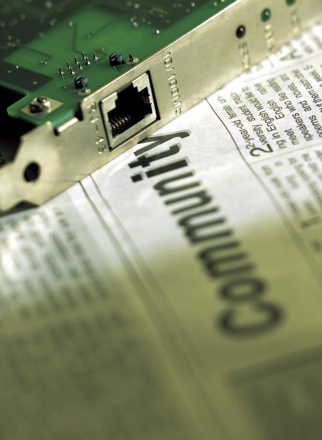 Close-up of hard drive on newspaper