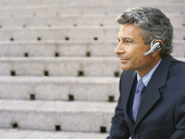 Side view of a mature businessman wearing a headset