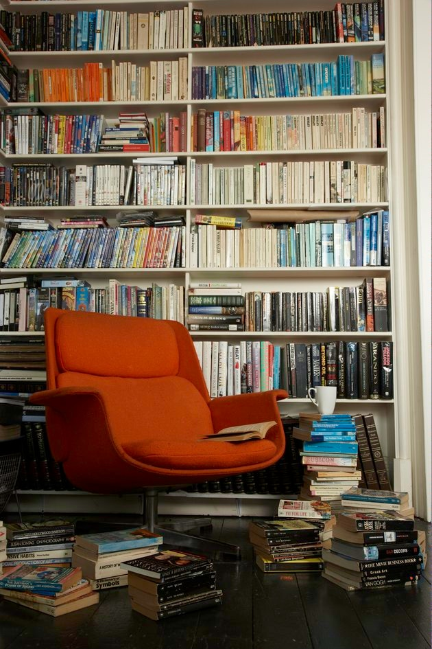 comfortable chair surrounded by books