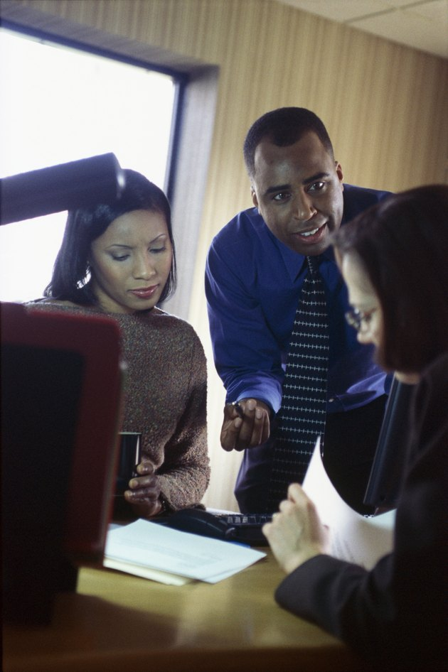 Business people going over report