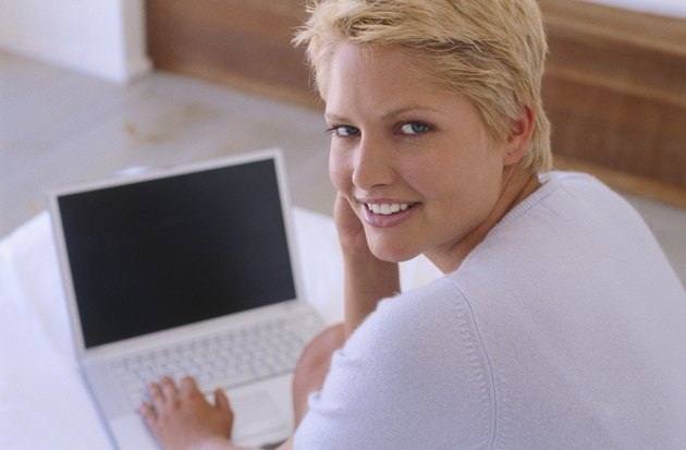 Portrait of a young woman working on a laptop