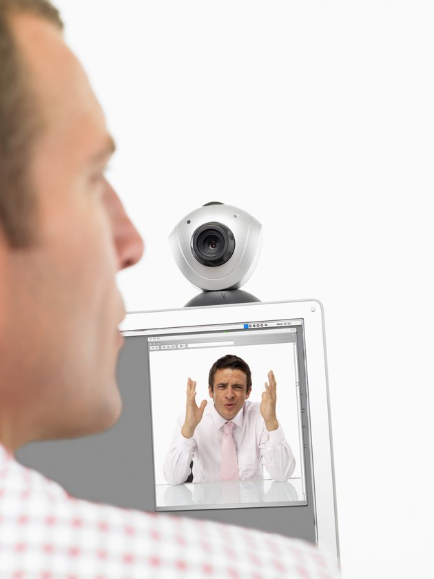 Businessmen communicating on webcam