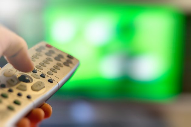 Close-up of TV remote control over a blurred background