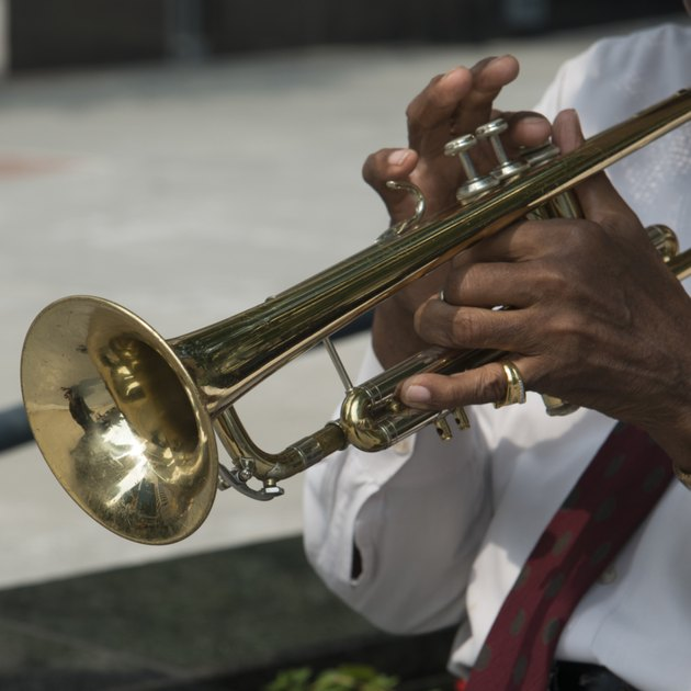 Mid section view of a man playing a trumpet, Chicago, Cook County, Illinois, USA