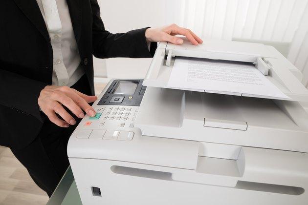 Businesswoman Pressing Printer's Button