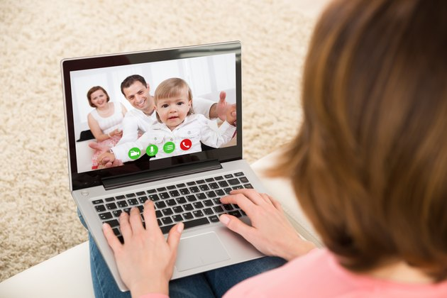 Woman Videochatting With Family On Laptop