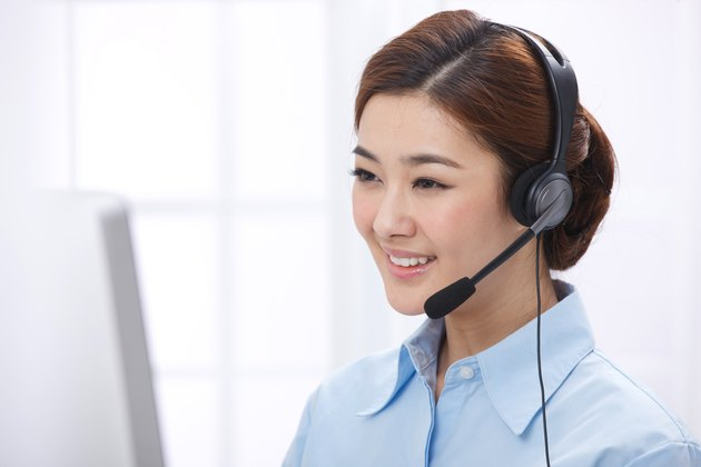 Young business lady wearing headset