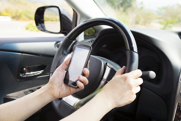 smart phone in hand  while driving