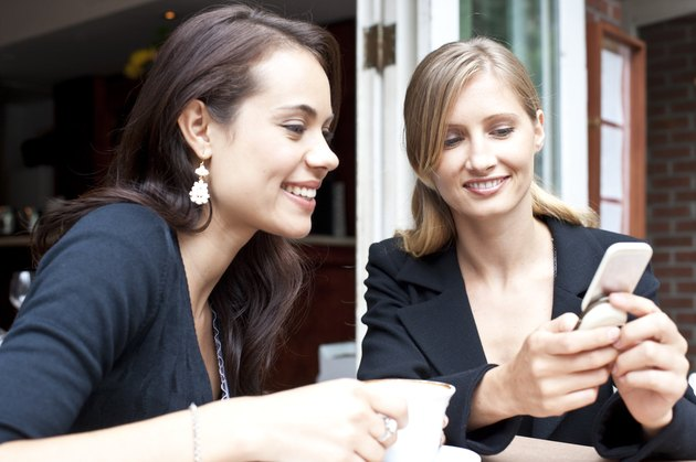 friends using smart phone at coffee shop